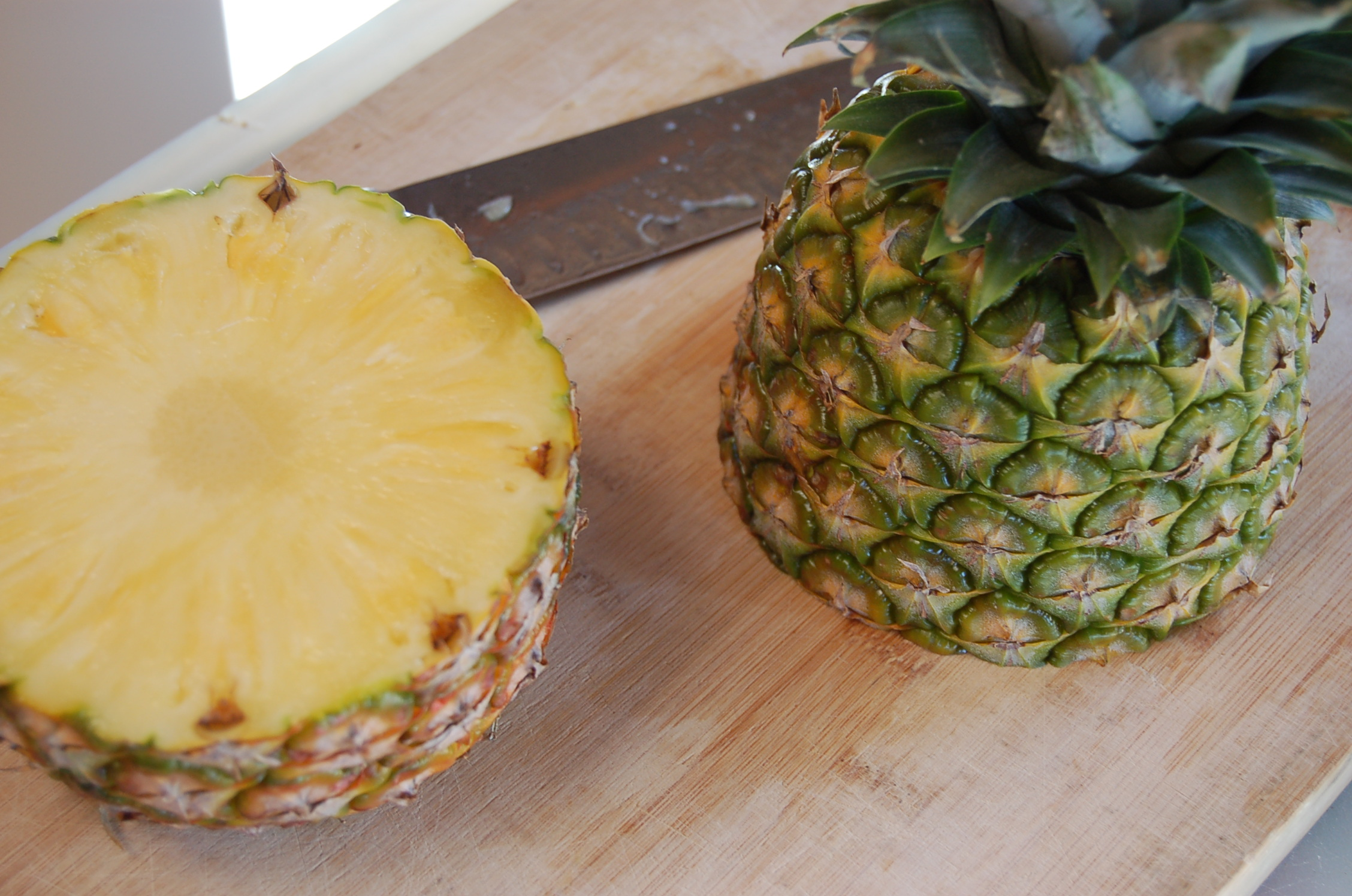 1 Cut pineapple in half